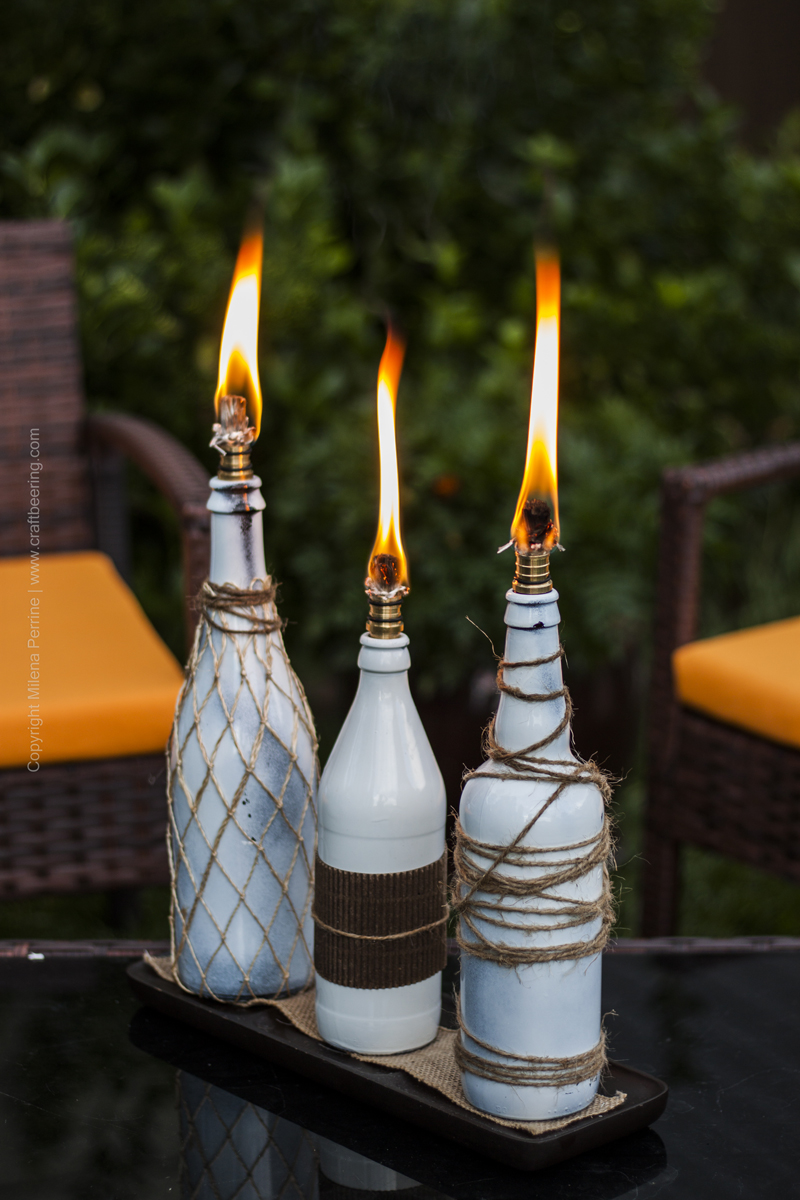 Beer Bottle Tiki Torches On Coffee Table.