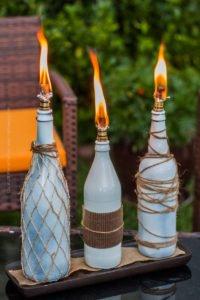 Beer bottle tiki torches arrangement