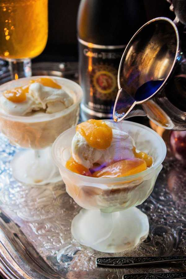 A Game of Thrones inspired dessert. Bend the Knee Golden Ale poached plums and lemon sorbet flambe