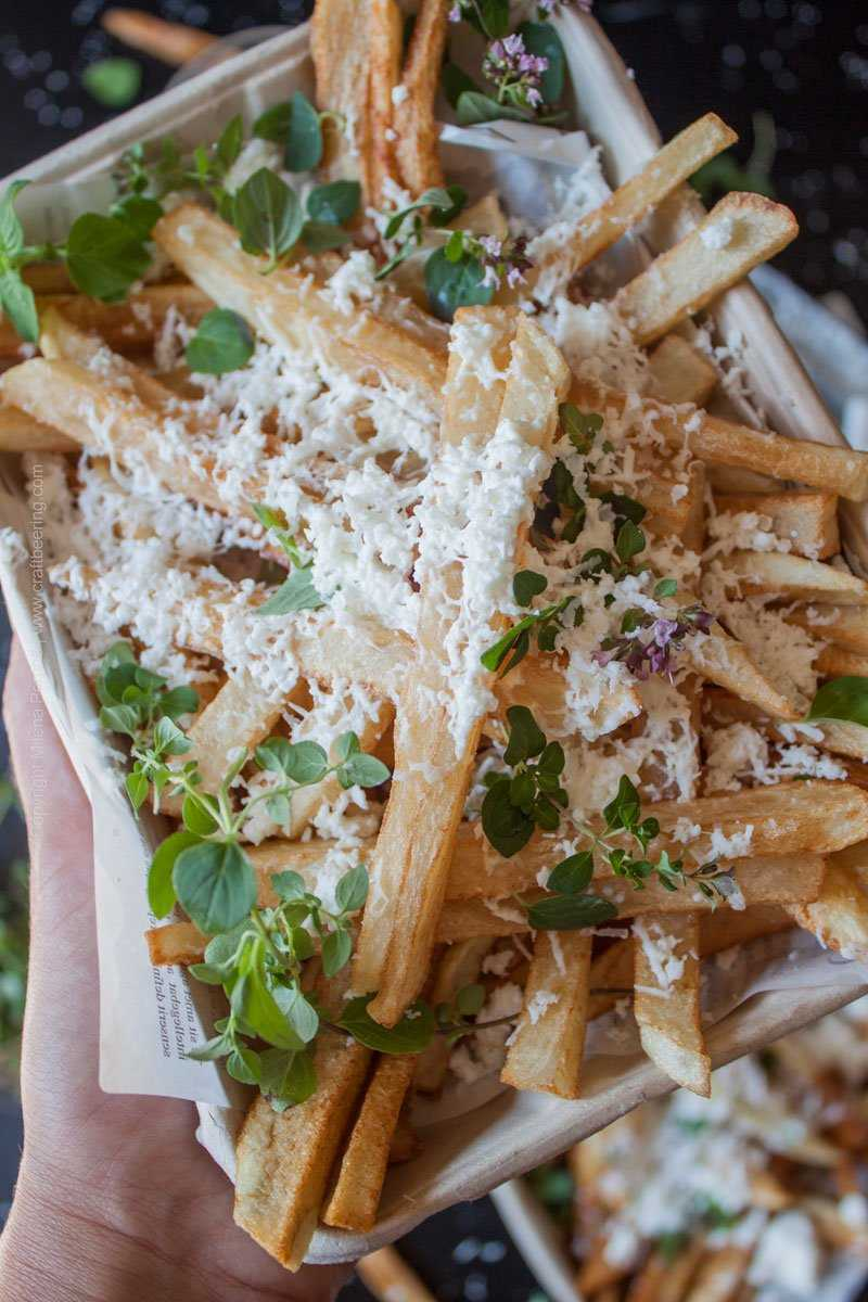 Bulgarian hand cut fries with Bulgarian feta cheese and oregano. #frieswithfeta #handcutfries