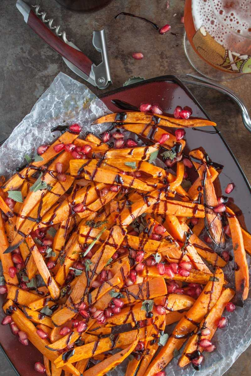 Saison butter sweet potato fries, oven roasted with sage, pomegranate seeds and balsamic reduction. #saisonbuttersweetpotatofries #roastedsweetpotatoes #sweetpotatofries
