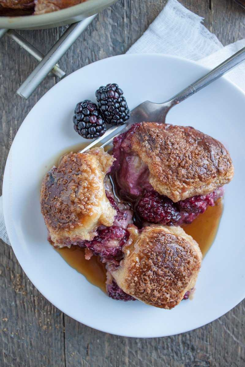 Beer French toast with Hawaiian rolls and blackberries.