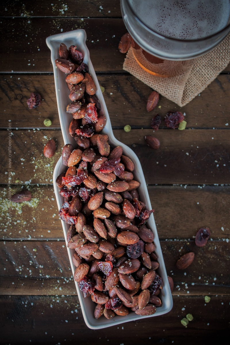 Roasted almonds with dried cranberries flavored by hops salt and served in a bottle shaped dish:) #roastedalmonds