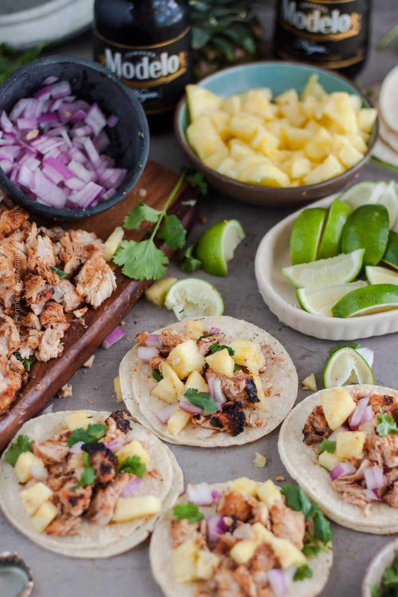 Tacos al Pastor | Traditional toppings are fresh diced pineapple, cilantro, diced onions and a squeeze of lemon juice.