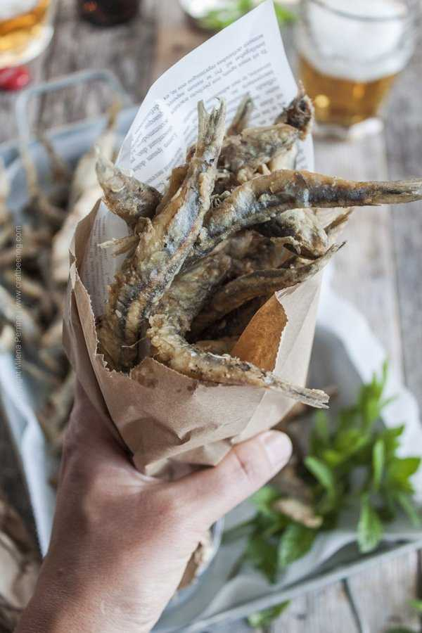 Fried anchovies or fried smelt served casual style in a paper cone.