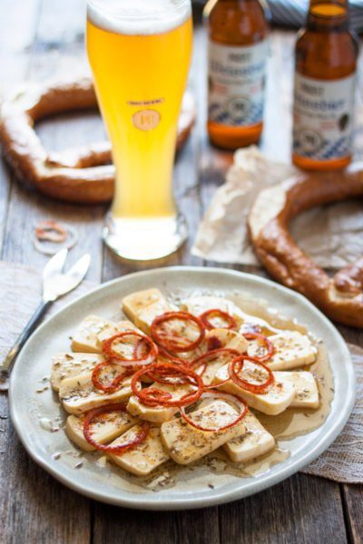 Limburger cheese presented as a salad with paprika coated onions and paired with Weissbier.