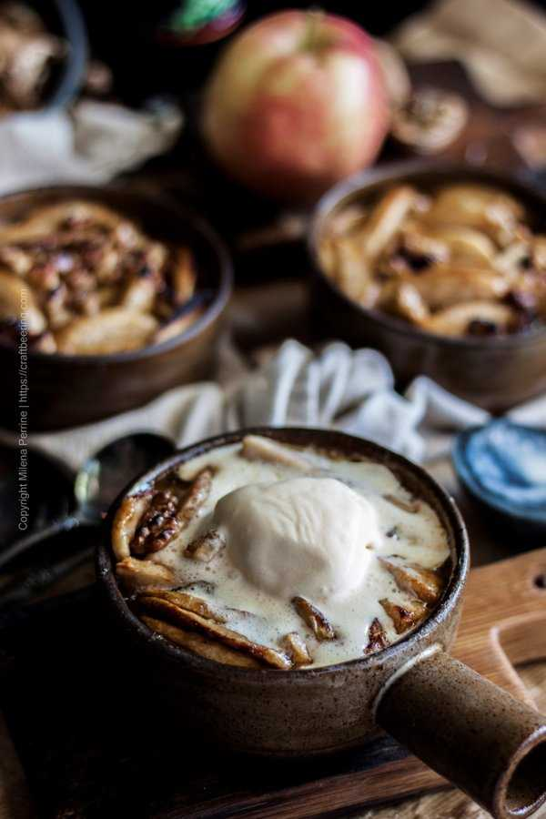 Slice baked apples in individual baking dish topped with vanilla ice cream.