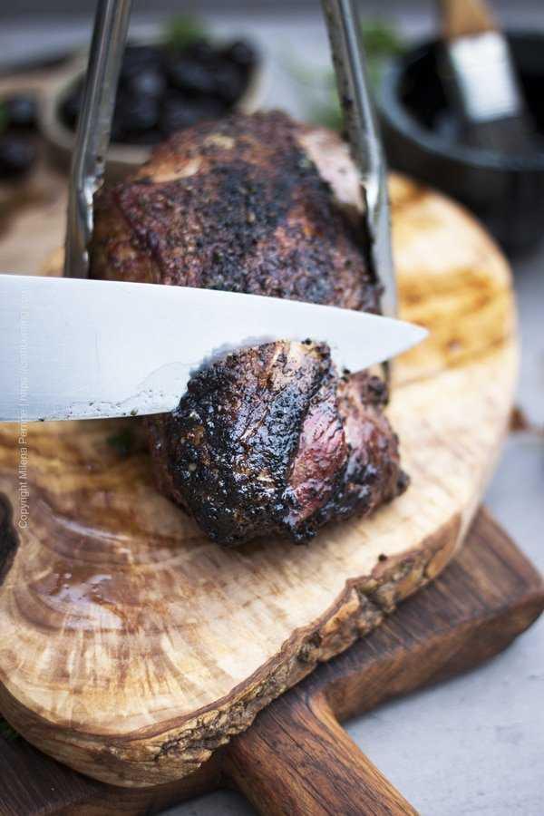 Carving a smoked leg of lamb.