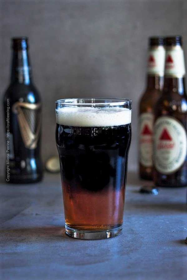 Poured Black and Tan beer with Bass at the bottom and Guinness on top